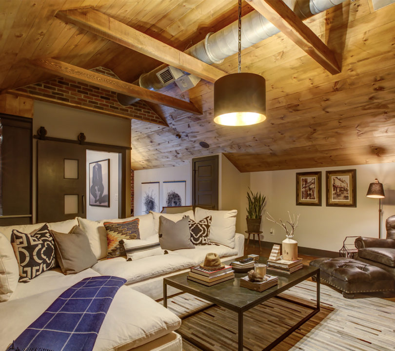 cozy remodeled attic with wood cieling and panels