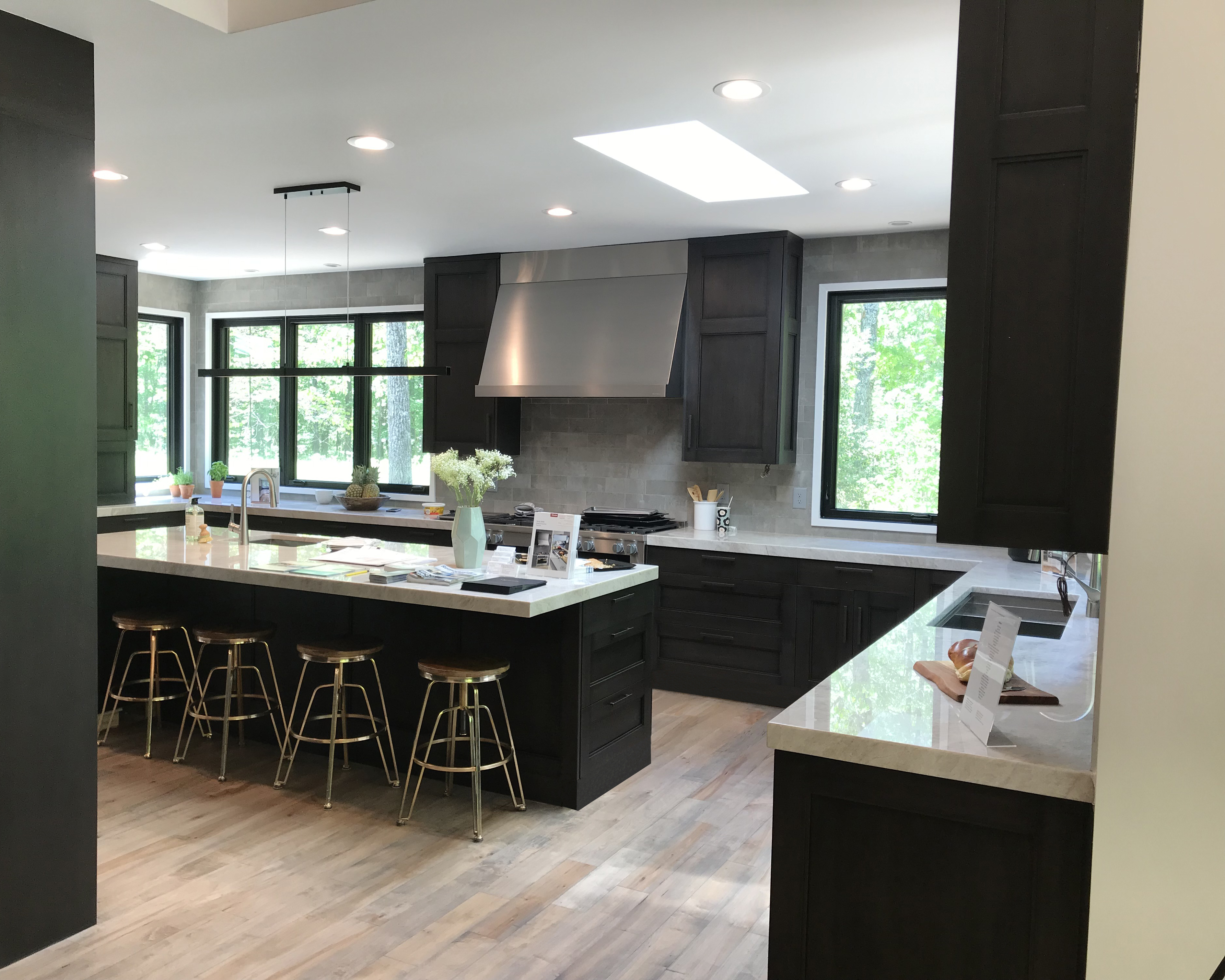 modern luxury kitchen with stainless steel hood and marble countertops
