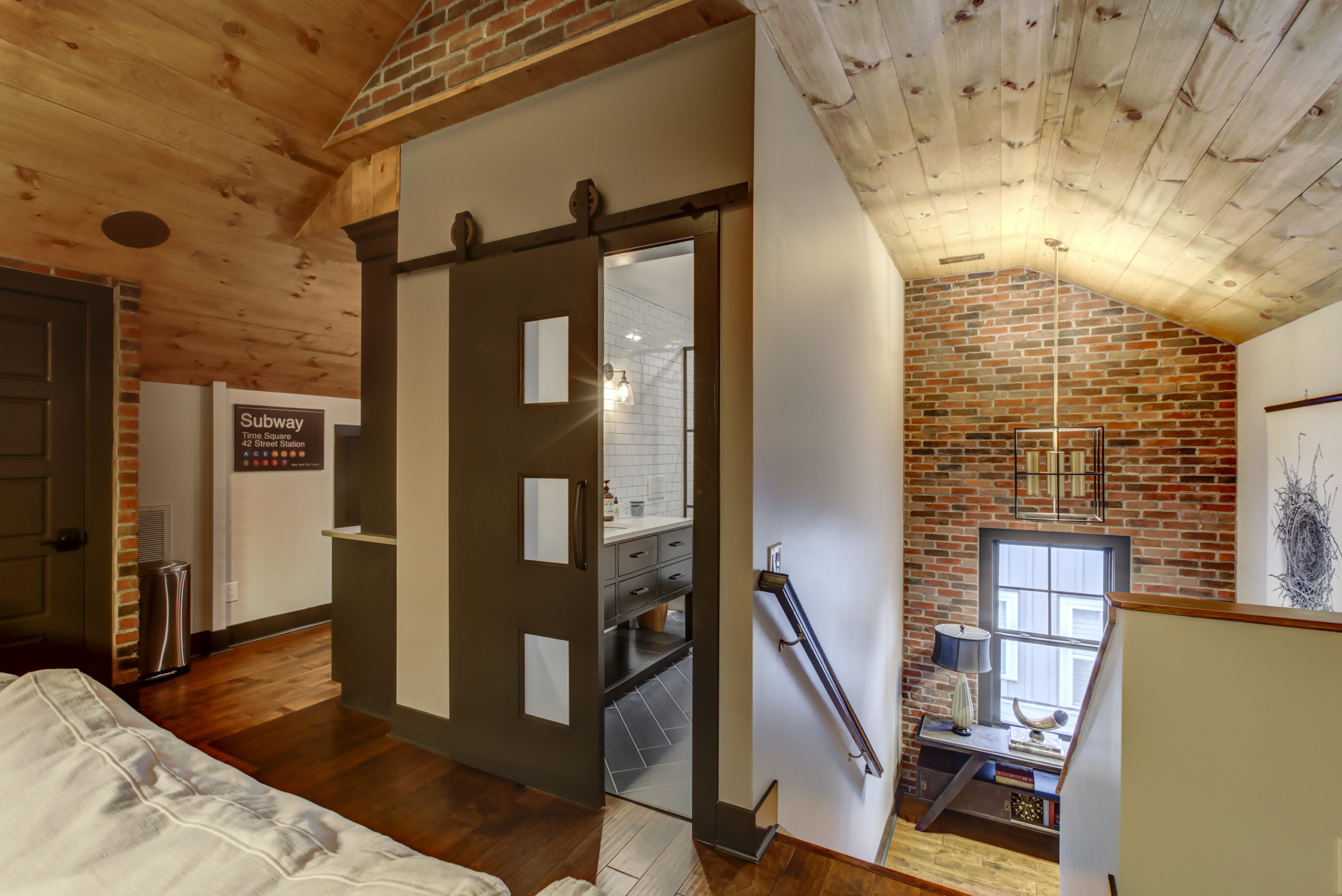 entrance to attic with bathroom and staircase