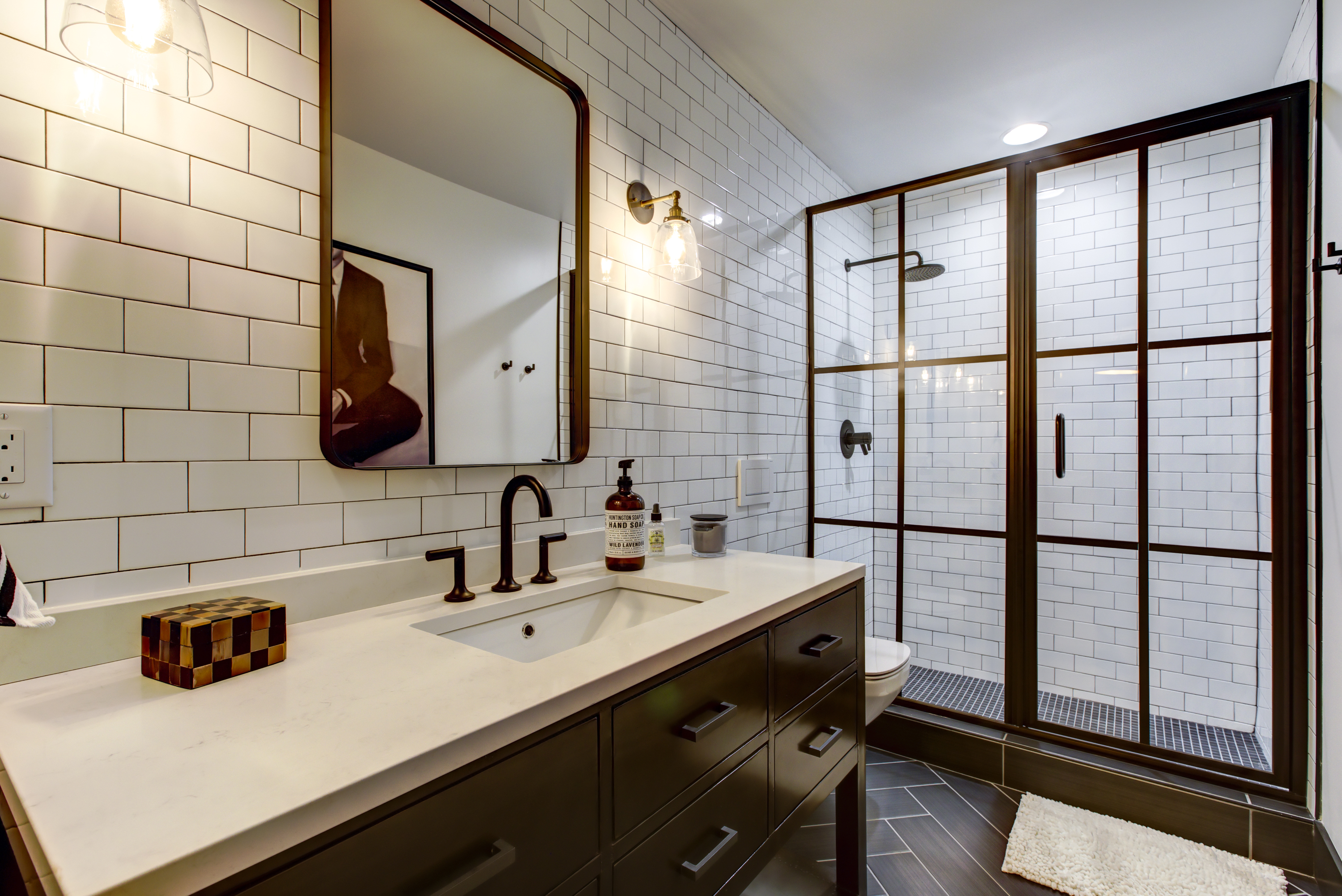 hall bath with modern shower door and white tile