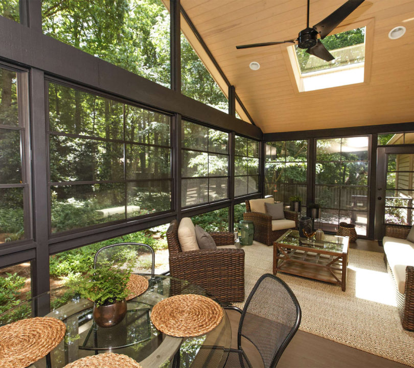 sun room with wood cieling and seating