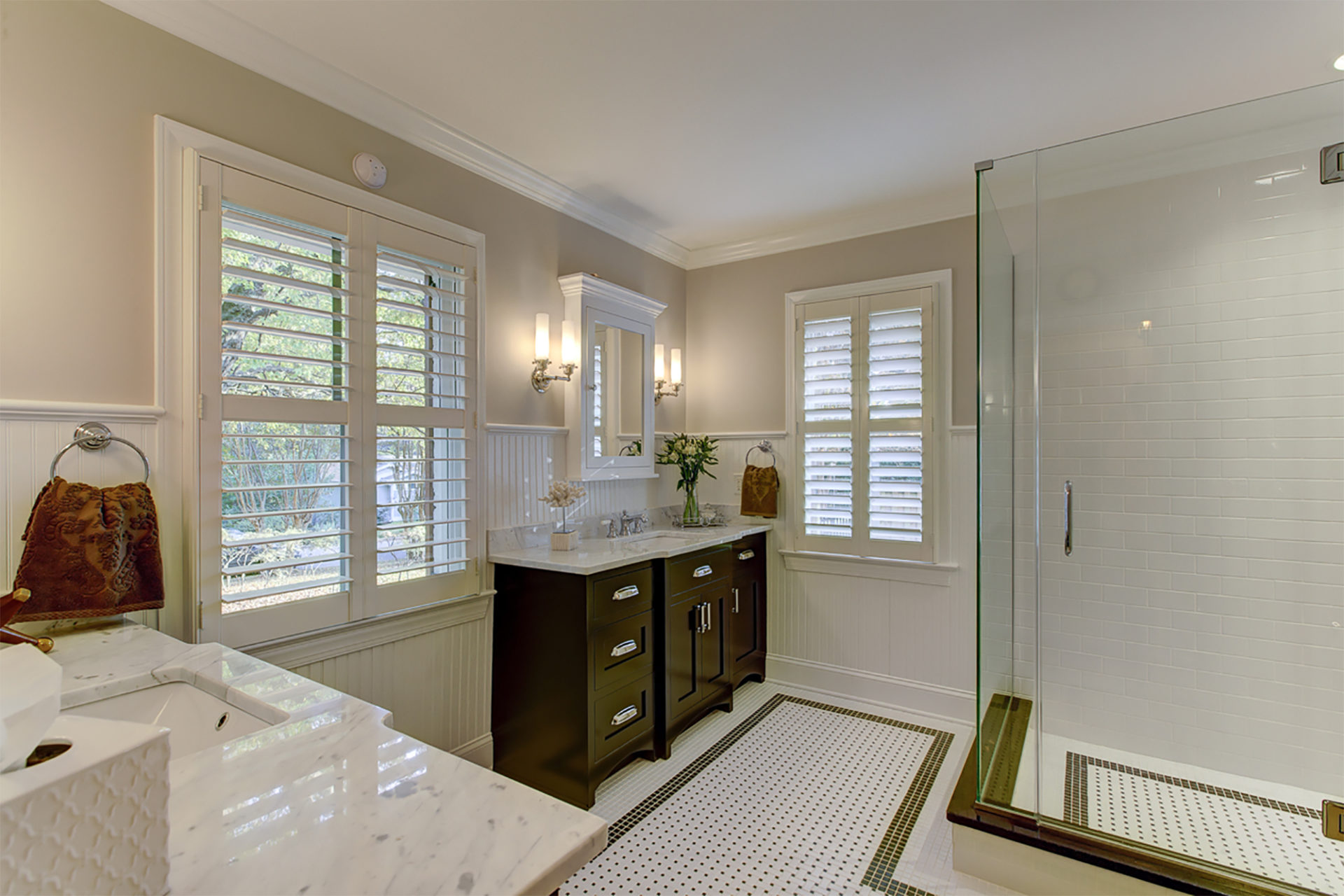 bathroom remodel with white floor tile and glass shower door