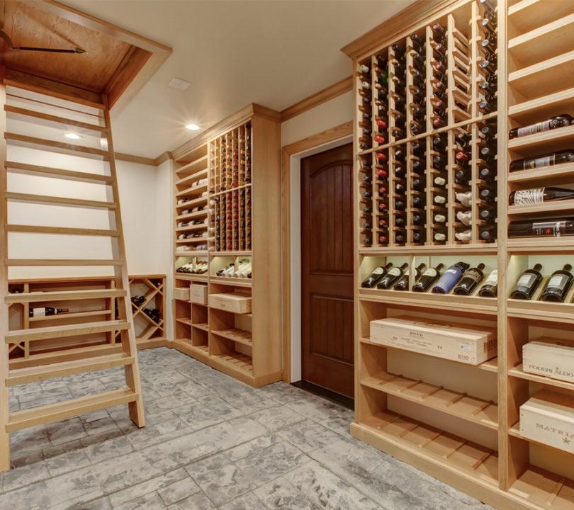 wooden shelves wine cellar with hidden entrance