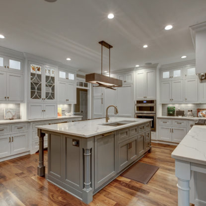 kitchen remodel with marble countertops and white cabinets