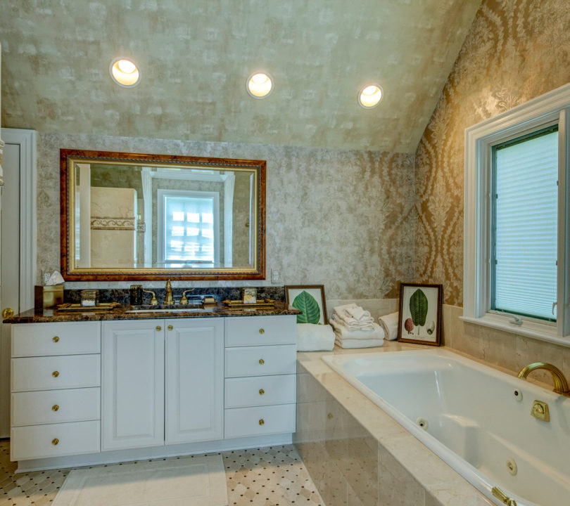 luxury bathroom remodel with gold and beige colors