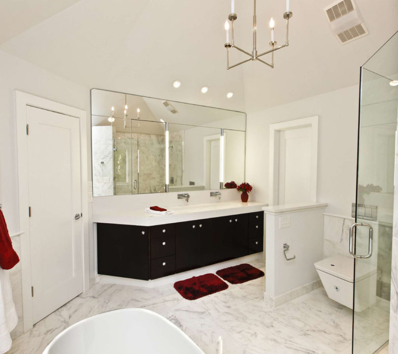 white bathroom with red accents