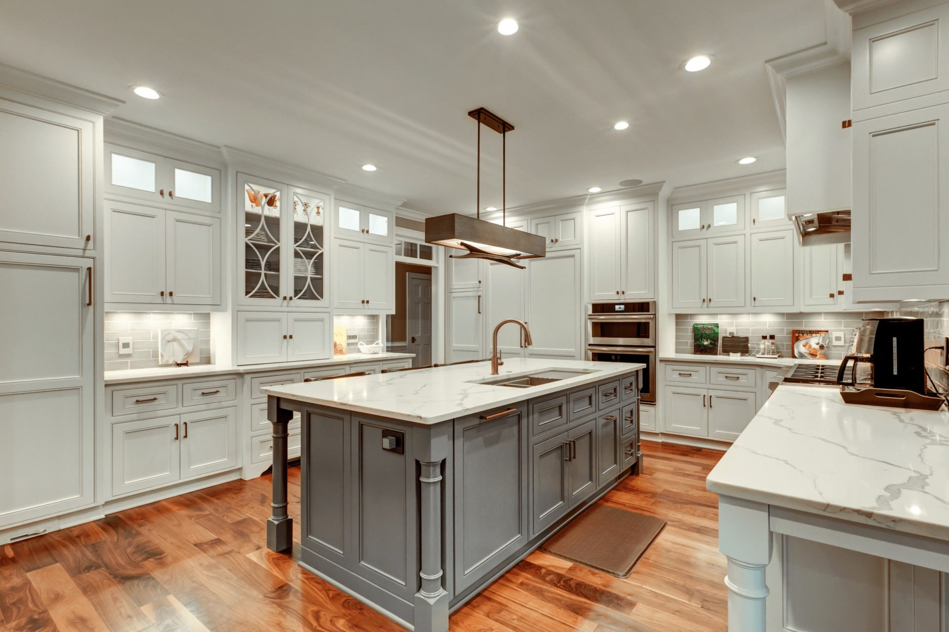 upscale kitchen with white marble countertops and white cabinets