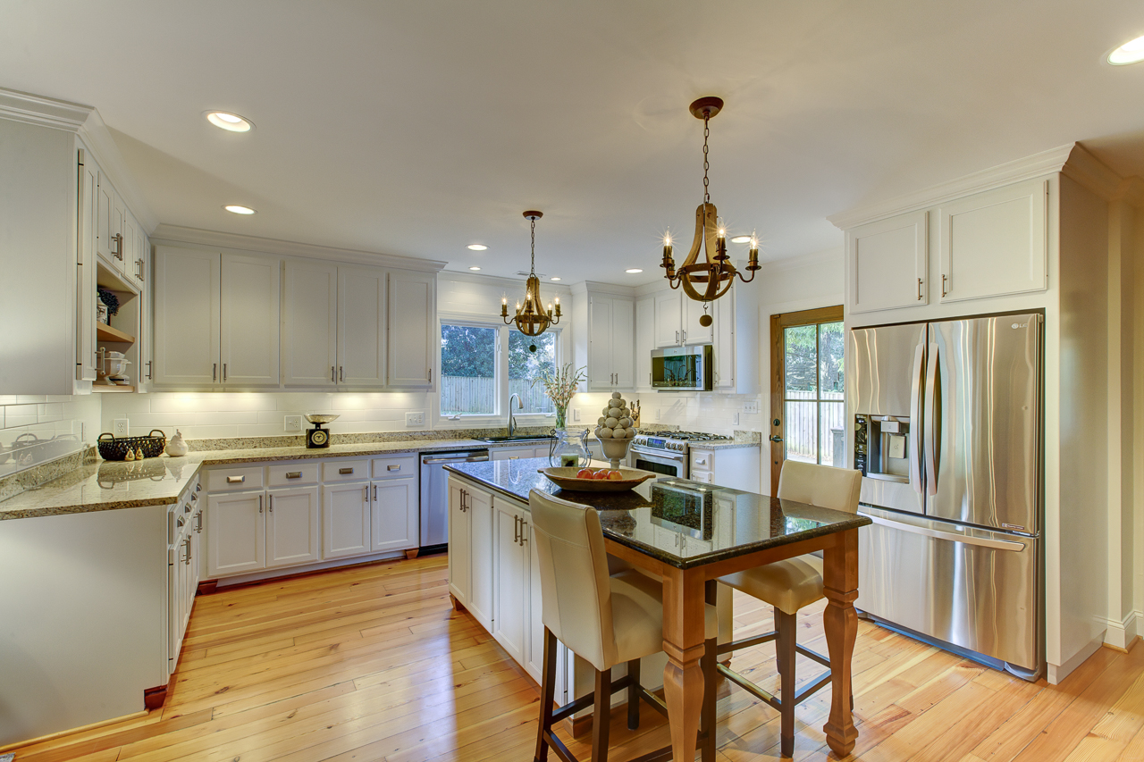 kitchen remodel with hardwood floors and white cabinets