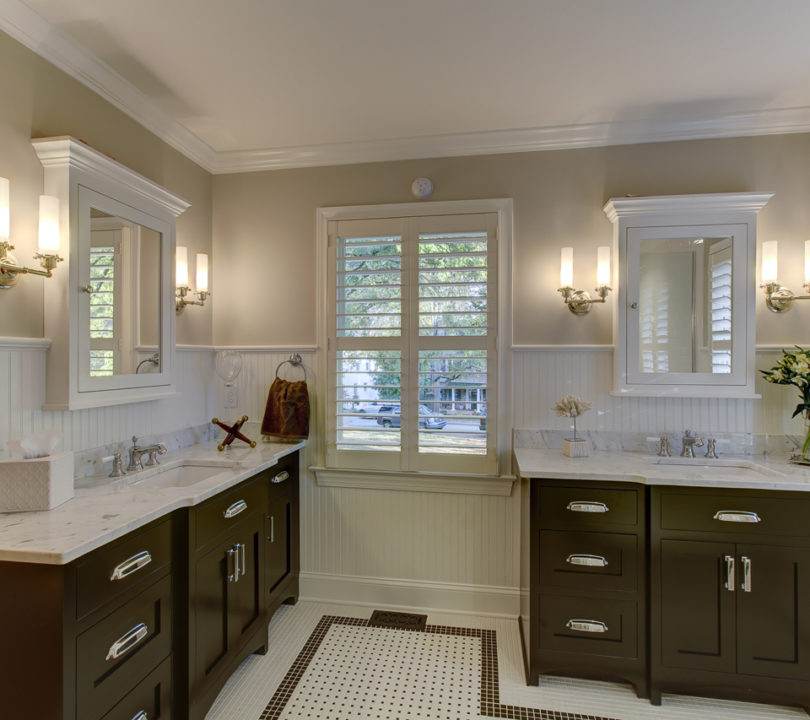 master bath with marble counters and beige walls